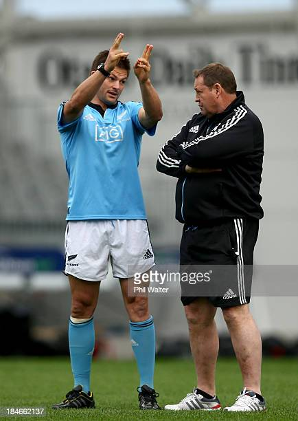 Richie McCaw of the All Blacks chats with coach Steve Hansen during a New Zealand All Blacks training session at the Forsyth Barr Stadium on October...