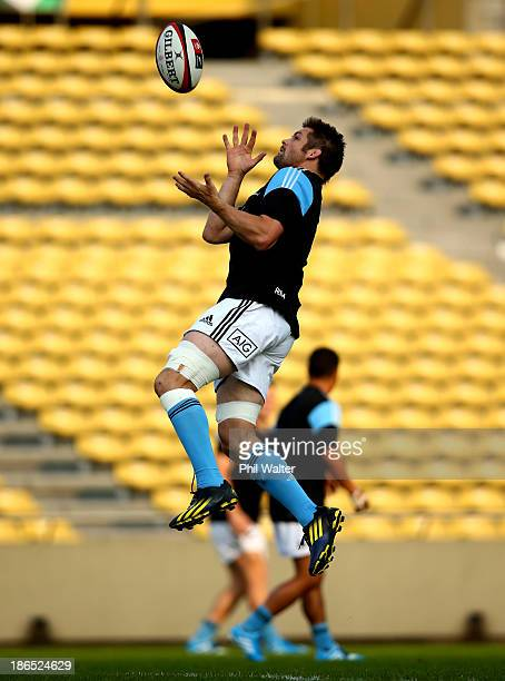 Richie McCaw of the All Blacks collects the high ball during the New Zealand All Blacks Captain's Run at Prince Chichibu Stadium on November 1 2013...