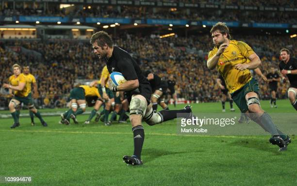 Richie McCaw of the All Blacks crosses for a try during the 2010 TriNations Bledisloe Cup match between the Australian Wallabies and the New Zealand...
