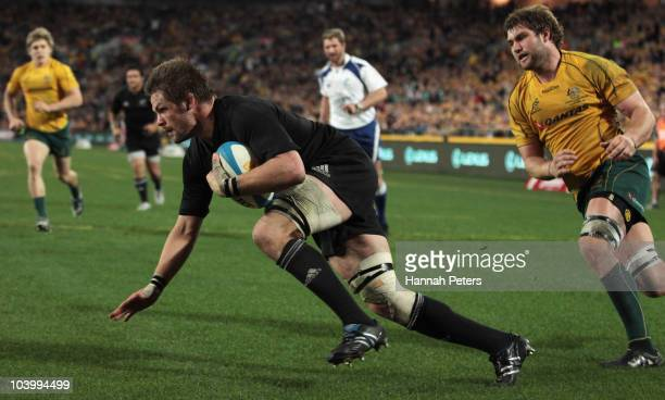 Richie McCaw of the All Blacks dives over to score during the 2010 TriNations Bledisloe Cup match between the Australian Wallabies and the New...