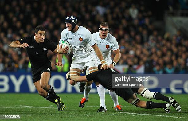 Richie McCaw of the All Blacks goes in for the tackle on Imanol Harinordoquy of France during the 2011 IRB Rugby World Cup Final match between France...