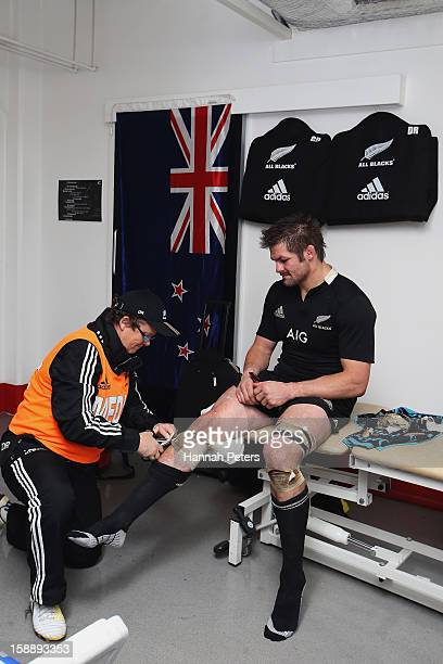 Richie McCaw of the All Blacks has his strapping removed following the international match between Wales and New Zealand at Millennium Stadium on...