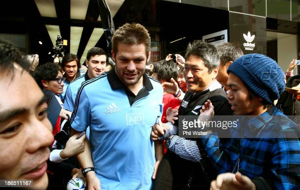 Richie McCaw of the All Blacks is mobbed by fans as he leaves the adidas store in Shibuya after meeting and greeting fans on November 1 2013 in Tokyo...