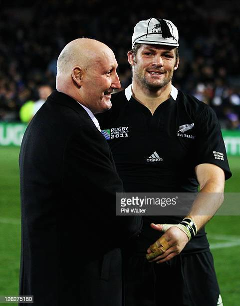 Richie McCaw of the All Blacks is presented with his 100th test cap by former All Black's captain and NZRU Chairman Jock Hobbs after the IRB 2011...