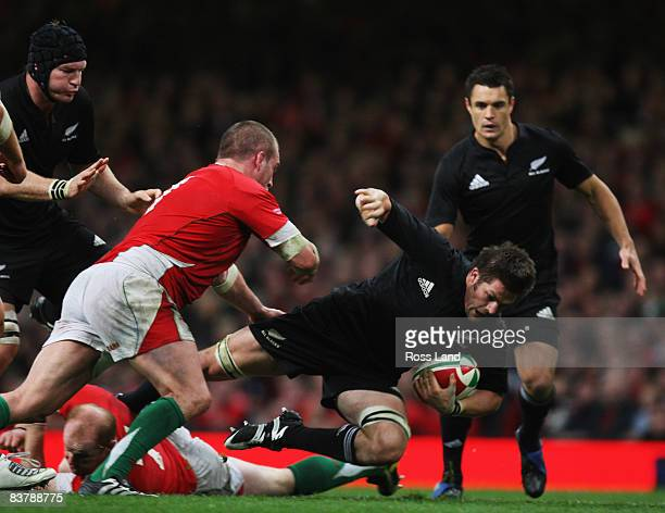 Richie McCaw of the All Blacks is tackled by Martyn Williams and gethin Jenkins during the Invesco Perpetual rugby match between Wales and the New...