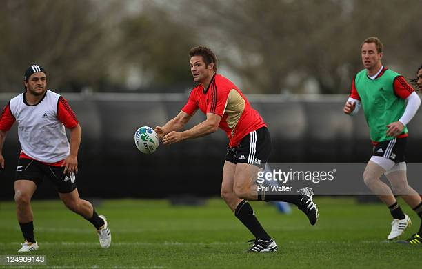 Richie McCaw of the All Blacks passes the ball during a New Zealand All Blacks IRB Rugby World Cup 2011 training session at St Peters College on...