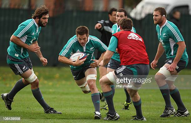 Richie McCaw of the All Blacks runs at the defence during a New Zealand All Blacks training session at Latymers Upper School on November 2, 2010 in...