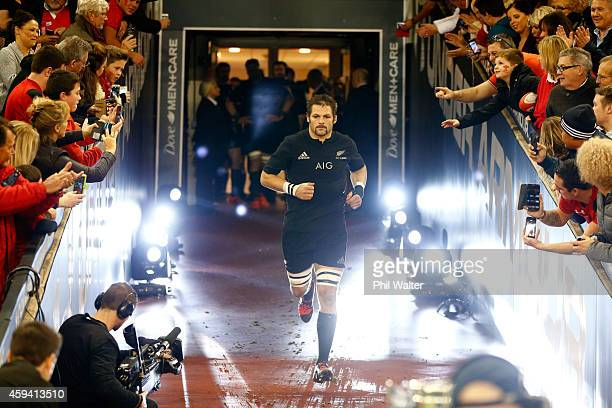 Richie McCaw of the All Blacks runs out onto the field for his 100th game as All Black captain during the Intenational match between Wales and the...