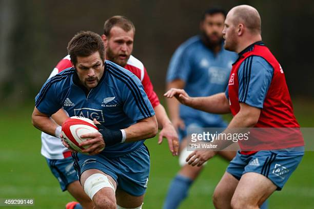 Richie McCaw of the All Blacks rusn the ball past Ben Franks during the New Zealand All Blacks training session at Sophia Gardens on November 20 2014...