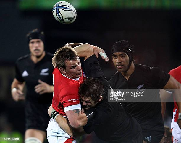 Richie McCaw of the All Blacks tackles Matthew Rees of Wales during the First Test match between the New Zealand All Blacks and Wales at Carisbrook...