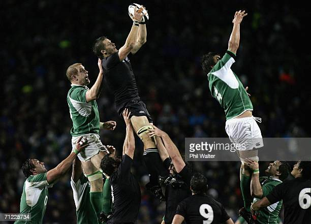 Richie McCaw of the All Blacks takes the ball in the lineout under pressure from Paul O'Connell during the international test match between the New...