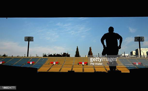 Richie McCaw of the All Blacks walks out onto the field for the New Zealand All Blacks Captain's Run at Prince Chichibu Stadium on November 1 2013 in...