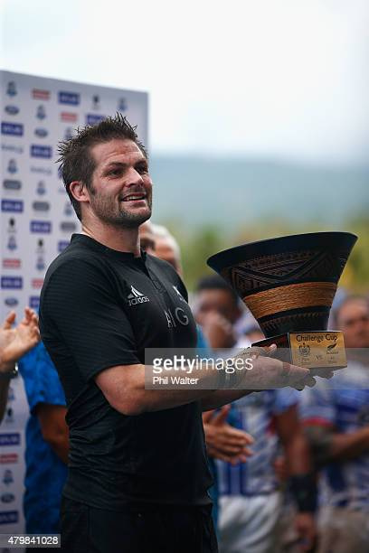 Richie McCaw of the All Blacks with the trophy following the International Test match between Samoa and the New Zealand All Blacks at Apia Stadium on...