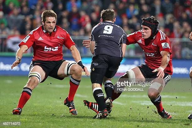 Richie McCaw of the Canterbury Crusaders tackles Marcell Coetzee of the Coastal Sharks with Matt Todd in support during the Super 15 rugby union semi...