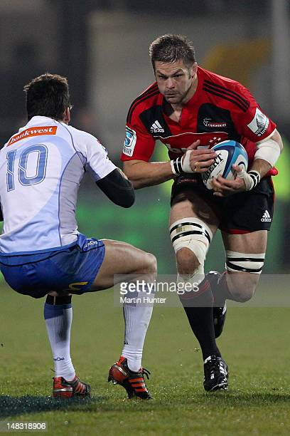 Richie McCaw of the Crusaders breaks through the tackle of Ben Seymour of the Force during the round 18 Super Rugby match between the Crusaders and...