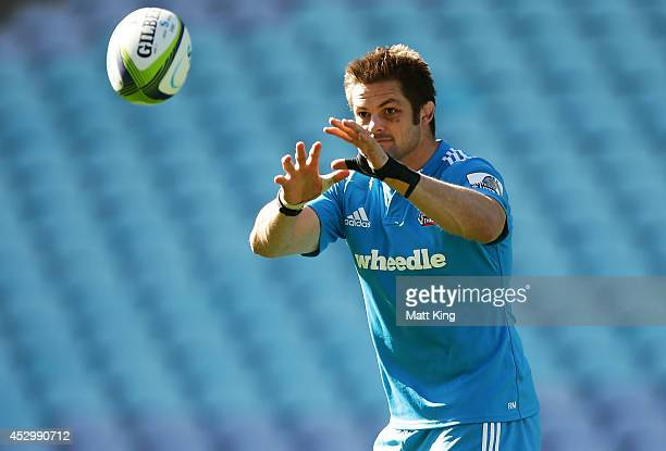 Richie McCaw of the Crusaders handles the ball during the Crusaders Super Rugby Grand Final Captain's Run at ANZ Stadium on August 1 2014 in Sydney...