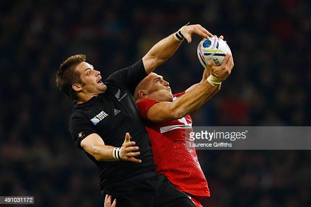 Richie McCaw of the New Zealand All Blacks and Lasha Lomidze of Georgia goes up for a line out ball during the 2015 Rugby World Cup Pool C match...