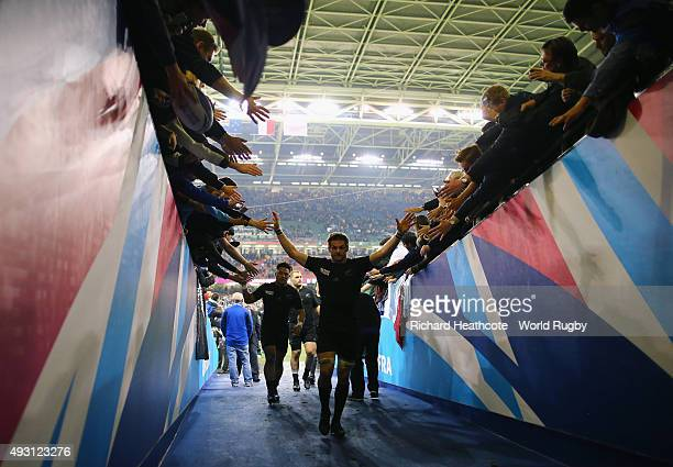 Richie McCaw of the New Zealand All Blacks celebrates with fans after victory in the 2015 Rugby World Cup Quarter Final match between New Zealand and...
