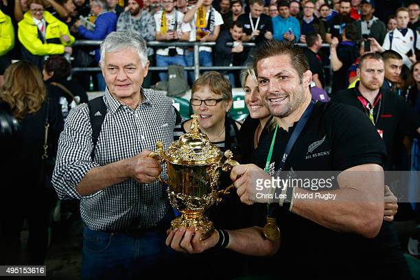 Richie McCaw of the New Zealand All Blacks celebrates with his family following victory against Australia in the 2015 Rugby World Cup Final match...
