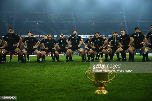 Richie McCaw of the New Zealand All Blacks leads his team as they perform a haka wearing their World Cup winners medals and the Webb Ellis Cup on the...