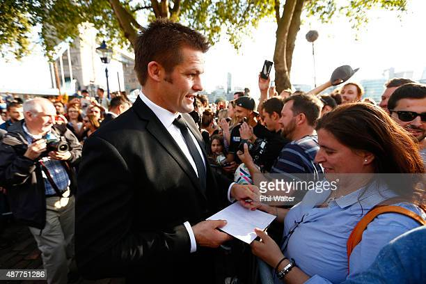 Richie McCaw of the New Zealand All Blacks meets with fans following their RWC 2015 Welcome Ceremony at the Tower of London on September 11, 2015 in...