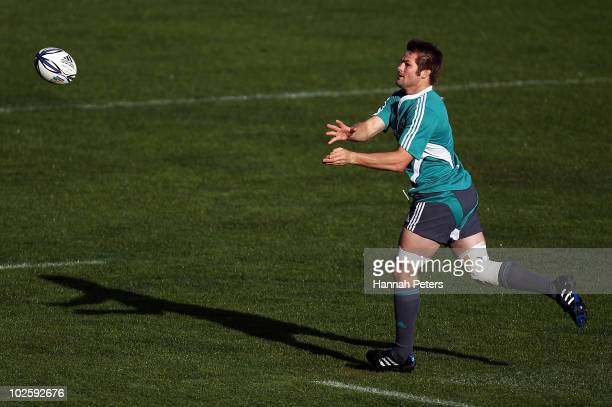 Richie McCaw passes the ball during a New Zealand All Blacks training session at North Harbour Stadium on July 3 2010 in Auckland New Zealand