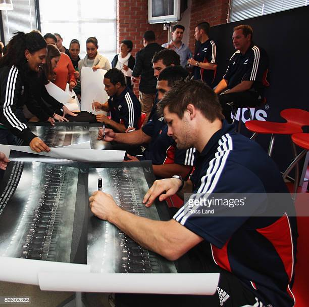 Richie McCaw signs posters during a visit to the adidas factory following a New Zealand All Black training session at Bishops School on August 14...