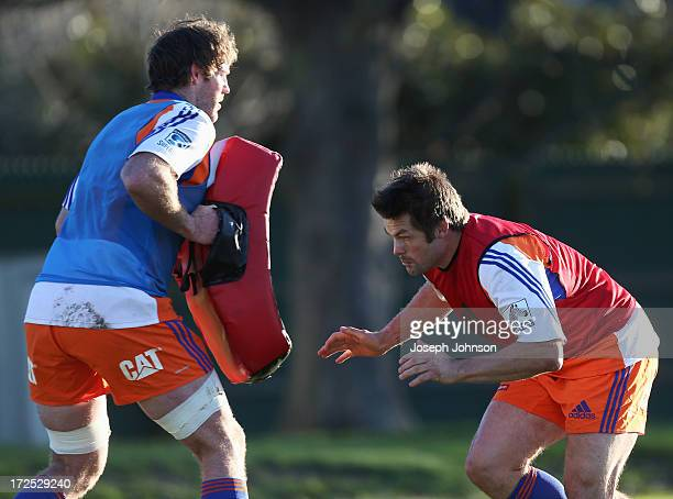 Richie McCaw tackles Tom Donnelly with tackle a bag during a Crusaders Super Rugby training session at Rugby Park on July 3 2013 in Christchurch New...