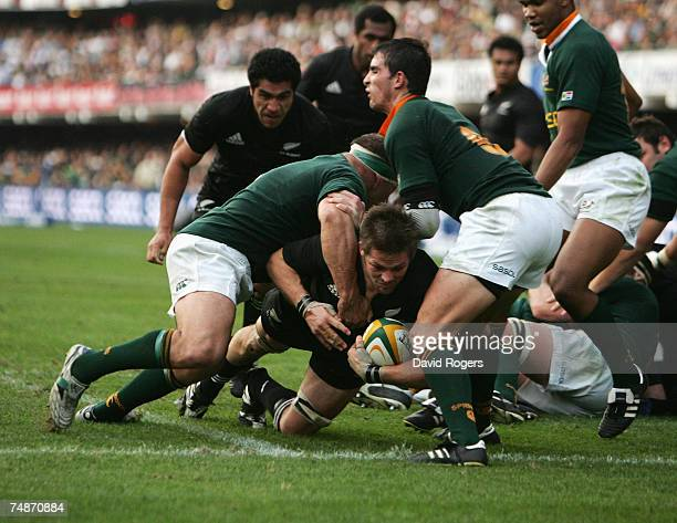 Richie McCaw the All Black captain dives over to score a try during the 2007 TriNations match between South Africa and New Zealand at the ABSA Kings...