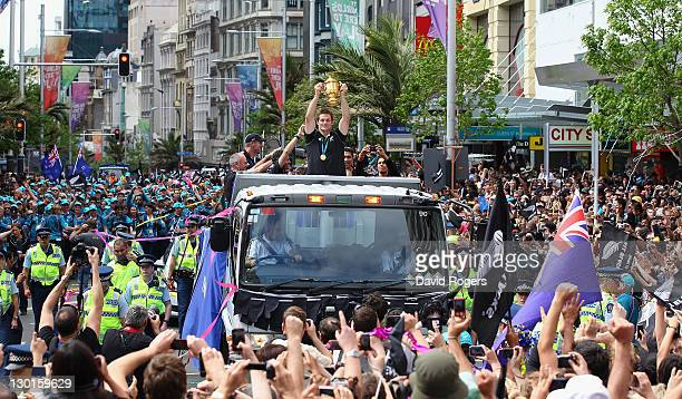 Richie McCaw the All Black captain shows the World Cup to the massed crowds during the New Zealand All Blacks 2011 IRB Rugby World Cup celebration...