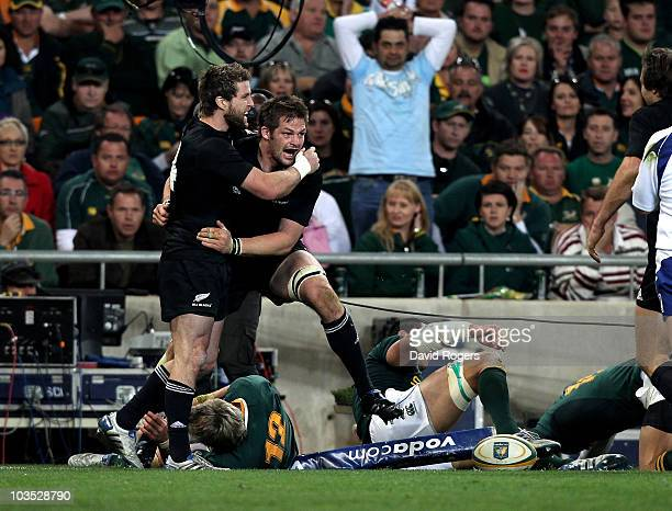 Richie McCaw the All Blacks captain celebrates with team mate Cory Jane after scoring a try during the 2010 TriNations match between the South...