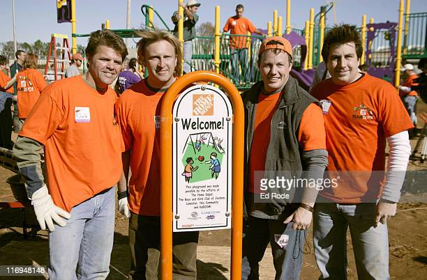 Richie McDonald Keech Rainwater Dean Sams Michael Britt pose in front of the playground they helped build