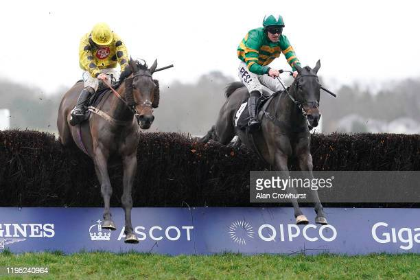 Richie McLernon riding Regal Encore clear the last to win The Dave Dawes Silver Cup Handicap Chase from Sean Bowen and Acting Lass at Ascot...