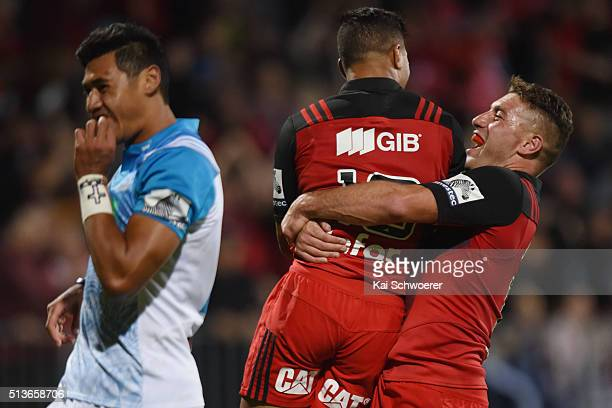 Richie Mounga and Kieron Fonotia of the Crusaders celebrate scoring a try during the round two Super Rugby match between the Crusaders and the Blues...
