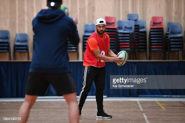 Richie Mo'unga looks to pass the ball during a Crusaders Super Rugby training session at St Andrew's College on July 23 2018 in Christchurch New...