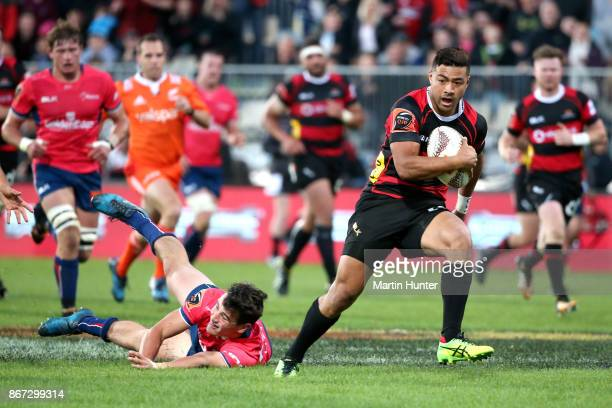 Richie Mo'unga of Canterbury breaks away from the tackle of Will Jordan of the Tasman Makos to score a try during the Mitre 10 Cup Premiership Final...