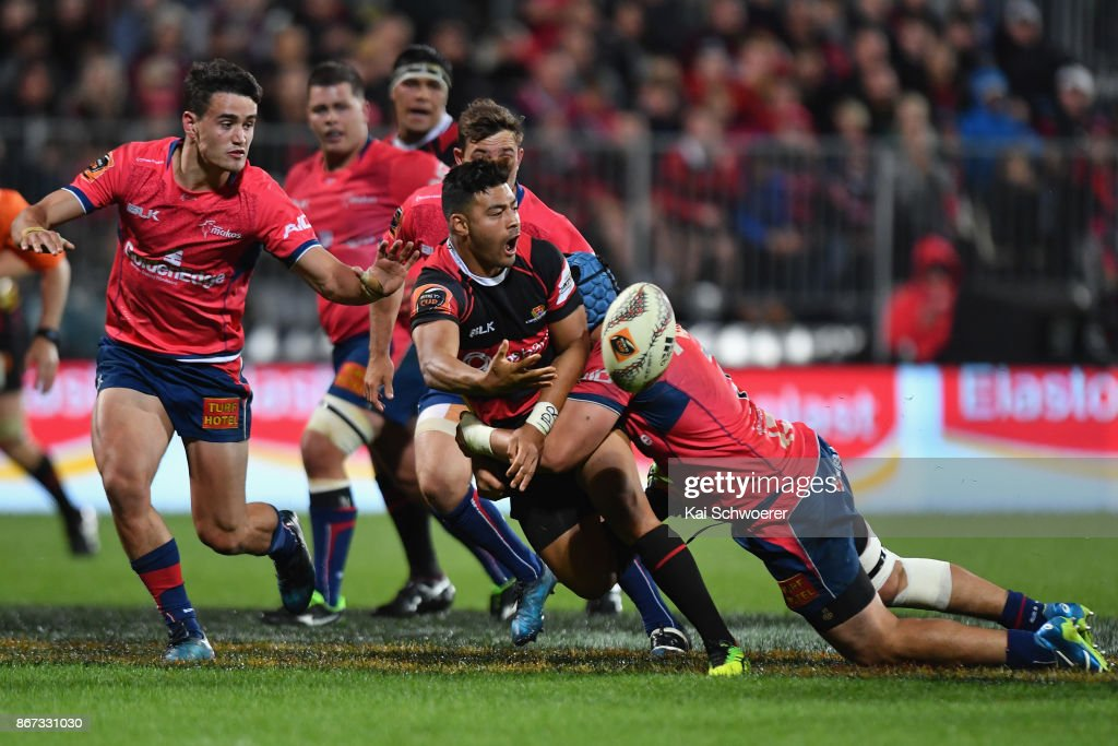 Richie Mo'unga of Canterbury offloads the ball during the Mitre 10 Cup Premiership Final match between Canterbury and Tasman at AMI Stadium on October 28, 2017 in Christchurch, New Zealand.