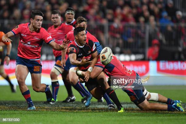 Richie Mo'unga of Canterbury offloads the ball during the Mitre 10 Cup Premiership Final match between Canterbury and Tasman at AMI Stadium on...
