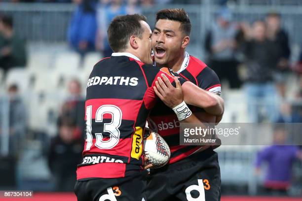 Richie Mo'unga of Canterburycelebrates with Tim Bateman after scoring a try during the Mitre 10 Cup Premiership Final match between Canterbury and...