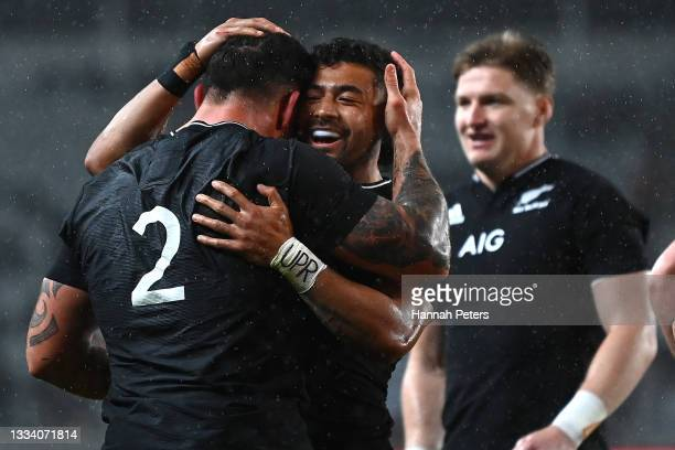 Richie Mo'unga of the All Blacks celebrates a try to Codie Taylor during The Rugby Championship and Bledisloe Cup match between the New Zealand All...