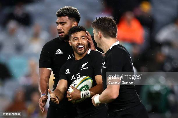 Richie Mo'unga of the All Blacks celebrates with Beauden Barrett and Hoskins Sotutu of the All Blacks after running in to score his second try during...