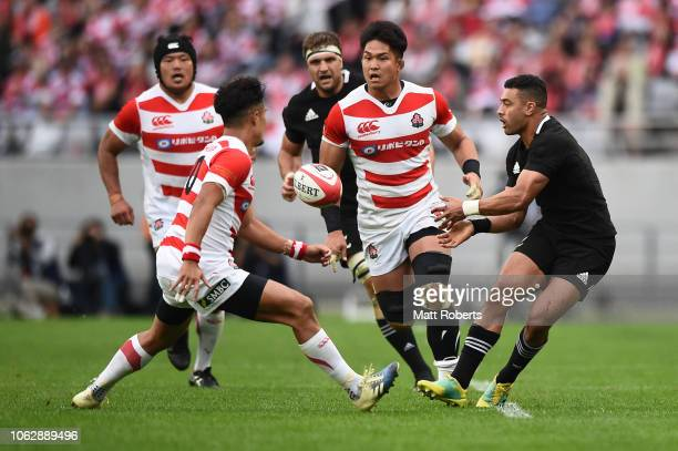 Richie Mo'unga of the All Blacks passes the ball during the test match between Japan and New Zealand All Blacks at Tokyo Stadium on November 03 2018...