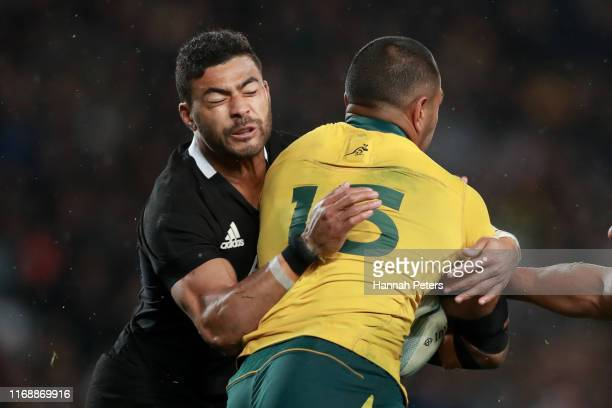 Richie Mo'unga of the All Blacks tackles Kurtley Beale of the Wallabies during the 2019 Rugby Championship Test Match between the New Zealand All...