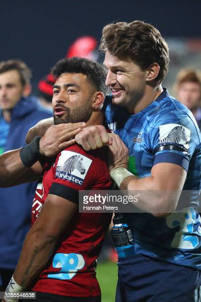 Richie Mo'unga of the Crusaders and Beauden Barrett of the Blues joke around following the round 5 Super Rugby Aotearoa match between the Crusaders...