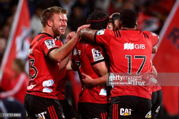 Richie Mo'unga of the Crusaders celebrates his try with teammates during the Super Rugby Quarter Final match between the Crusaders and the...