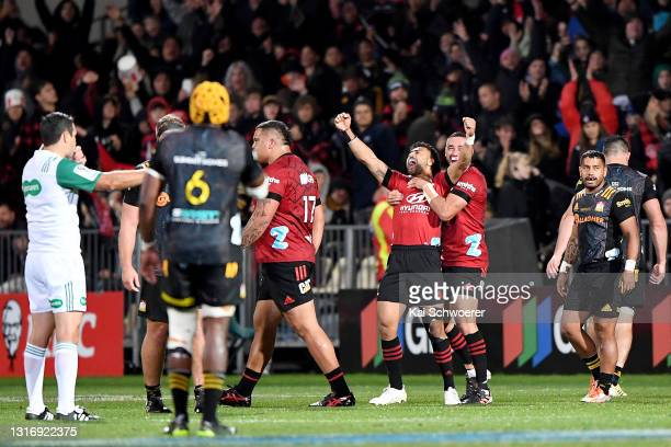 Richie Mo'unga of the Crusaders celebrates on full time with Bryn Hall during the Super Rugby Aotearoa Final match between the Crusaders and the...