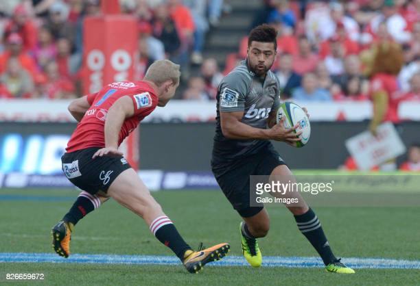 Richie Mo'unga of the Crusaders challenged by Ross Cronje of the Lions during the Super Rugby Final match between Emirates Lions and Crusaders at...