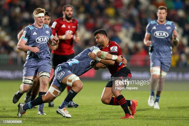 Richie Mo'unga of the Crusaders charges forward during the round 7 Super Rugby Aotearoa match between the Crusaders and the Hurricanes at...