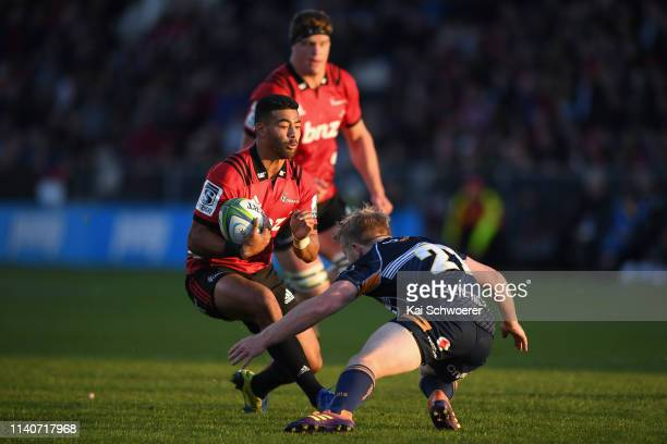 Richie Mo'unga of the Crusaders charges forward during the round 8 Super Rugby match between the Crusaders and Brumbies at Christchurch Stadium on...