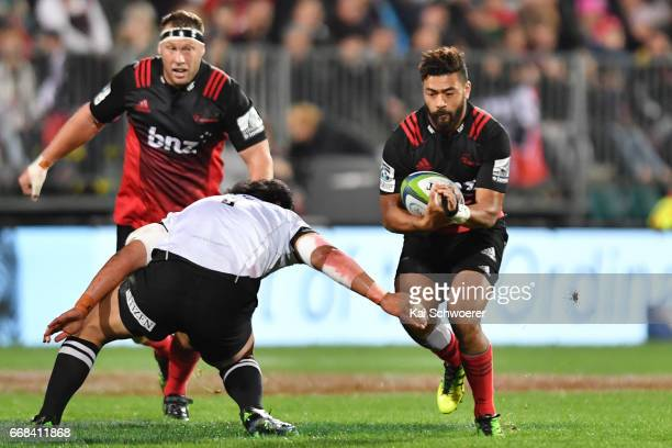 Richie Mounga of the Crusaders charges forward during the round eight Super Rugby match between the Crusaders and the Sunwolves at AMI Stadium on...